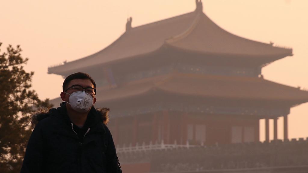 北京霧霾已籠罩全國1/6土地。(中新社圖片)